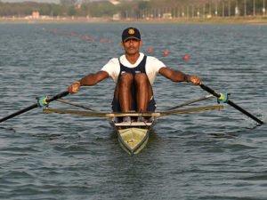 In this photograph taken on May 2, 2016, Indian rower Dattu Bhokanal takes part in a training session at the College of Military Engineering in Pune. Dattu Bhokanal, a rower from a drought-stricken village in dusty western India where residents don't have enough to drink has achieved an improbable feat -- he's qualified for the summer Olympics in Rio. / AFP PHOTO / INDRANIL MUKHERJEE / TO GO WITH AFP STORY Oly-2016-IND-rowing-weather-drought,INTERVIEW
